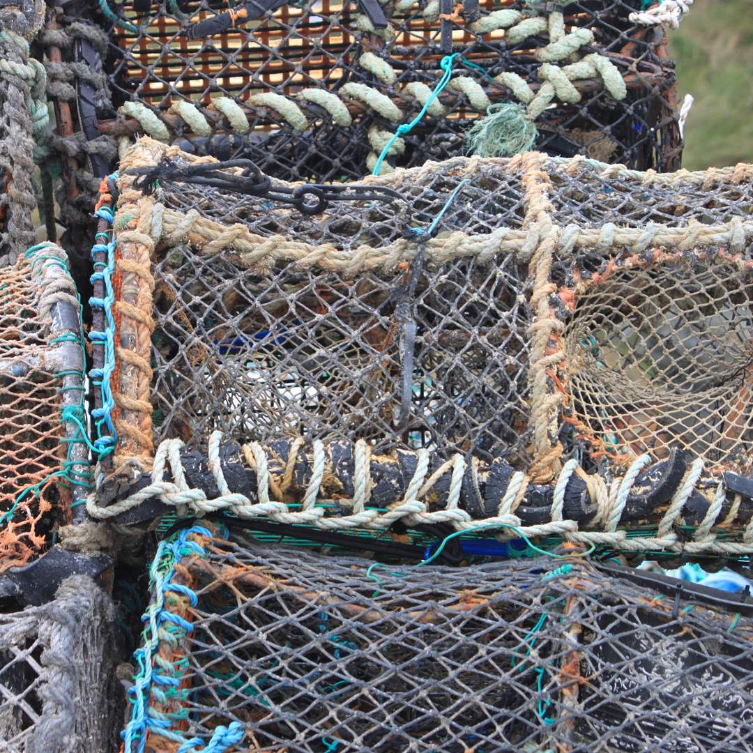 Lobster pots at the harbour at Mevagissey Cornwall Continue readinghellip